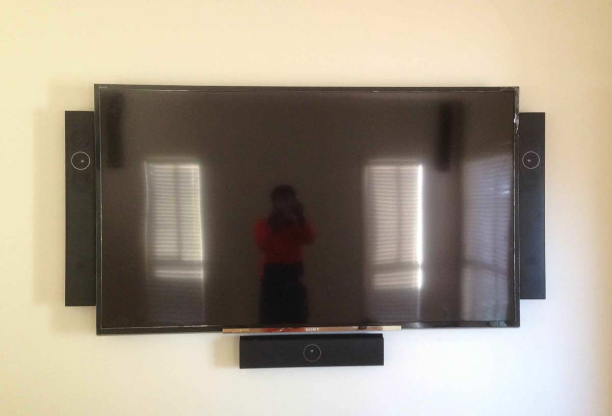 TV Wall mount with speaker mounts
